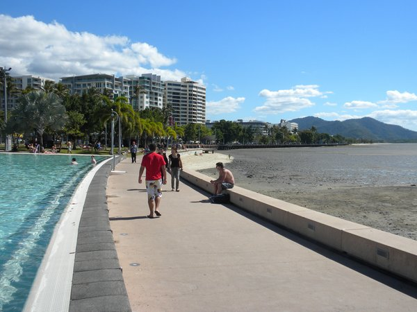 Cairns is a waterfront tourist town and retreat for Aussies escaping the winter weather. Though on the coast, it lacks a proper beach due to its large, long mud flats. Instead, the center of town features the Cairns Esplanade Pool, a public saltwater pool/fountain/lagoon.