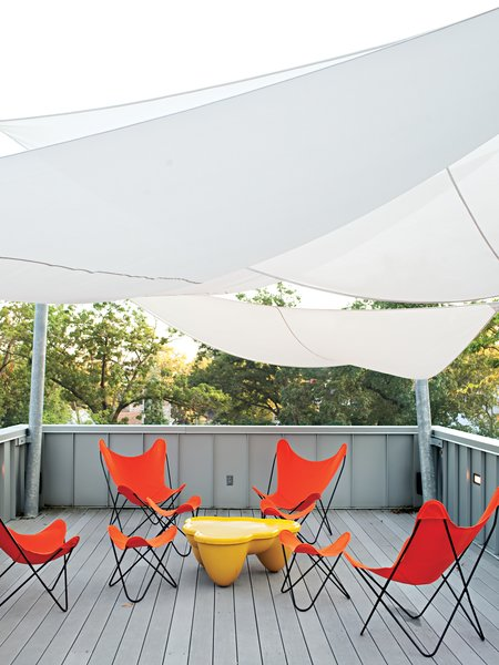 The Church Residence in Michigan City, Indiana, is topped with a generous porch equipped with a hot tub and solar sail shades fabricated by Covers Unlimited.