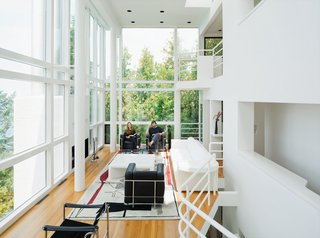 Michael McCarthy and Marcia Myers spent years rehabilitating the Douglas House. The double-height living room features a custom sofa and low table of Meier's design, and an Edward Fields rug based on a sketch Le Corbusier created in 1956 for a Tokyo theater.