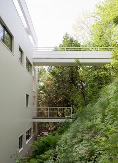 There are two walkways that extend over this sloping hillside. The top-most walkway is the intended entrance.
