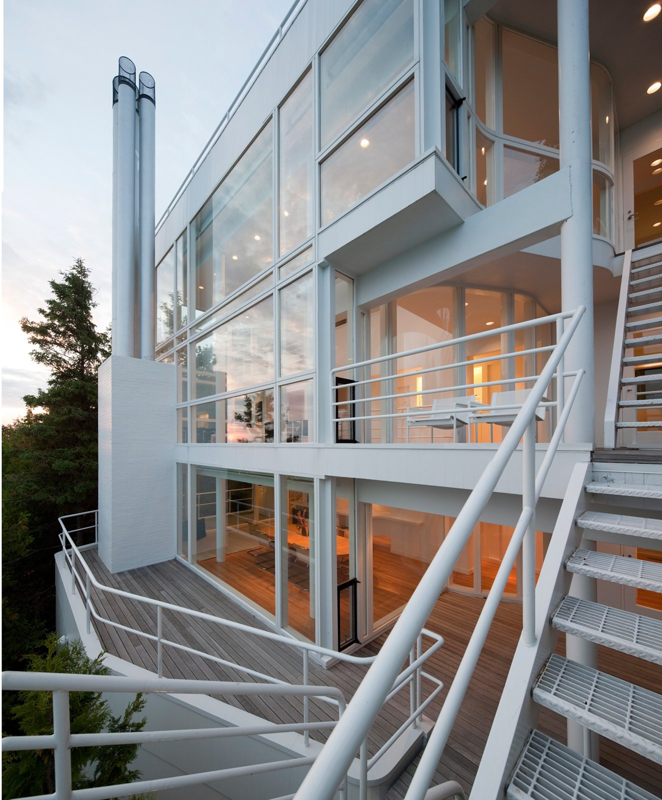 The rear facade is a complex articulation of angles and walkways.  Photo 15 of 22 in This Lake House Is a Living Piece of Architecture History