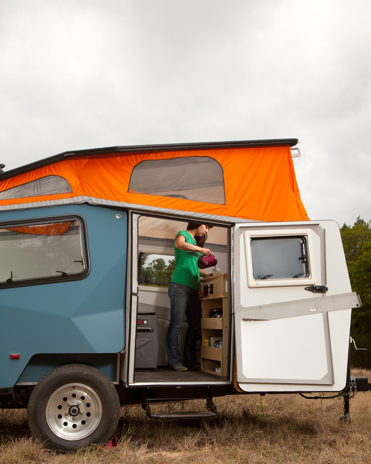 In travel mode, the Cricket Trailer measures 15 feet long, six and a half feet wide, and six feet ten inches tall (ground to roof), but when the top is popped up, it provides six feet two inches of interior headspace.  Photo 7 of 15 in Modern NASA-Inspired Cricket Trailer