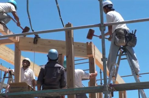 The construction crew erected the Onjuku House frame in just one day, using wooden mallets to coax each piece into position.  Photo 3 of 4 in Video: Prefab Japanese Joinery