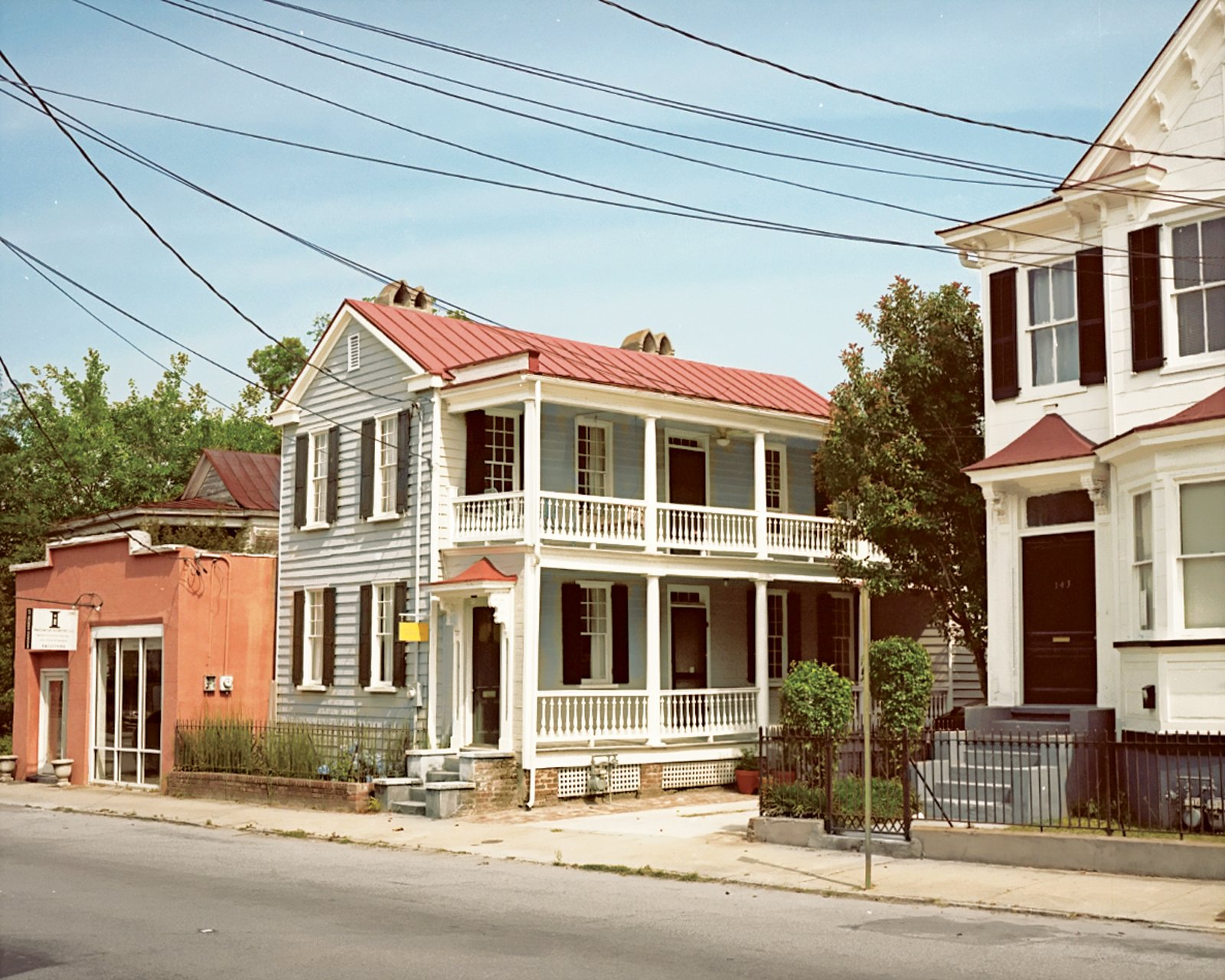 """The nineteenth-century structure is commonly known as a classic """"Charleston single"""".  12 Porches Across America by Diana Budds from Raise High the Roof Beams"""