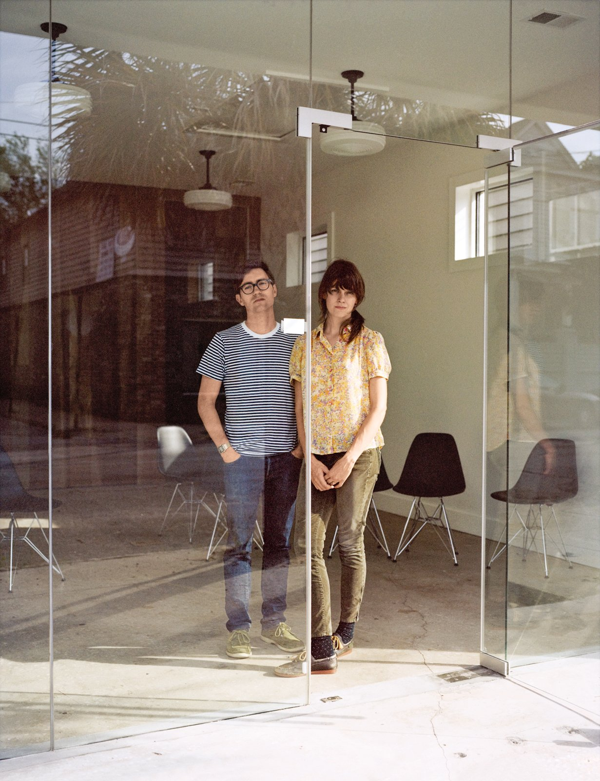 Josh Nissenboim and Helen Rice inside Fuzzco, their design firm, Fuzzco, headquartered just down the street.  Photo 17 of 18 in Raise High the Roof Beams
