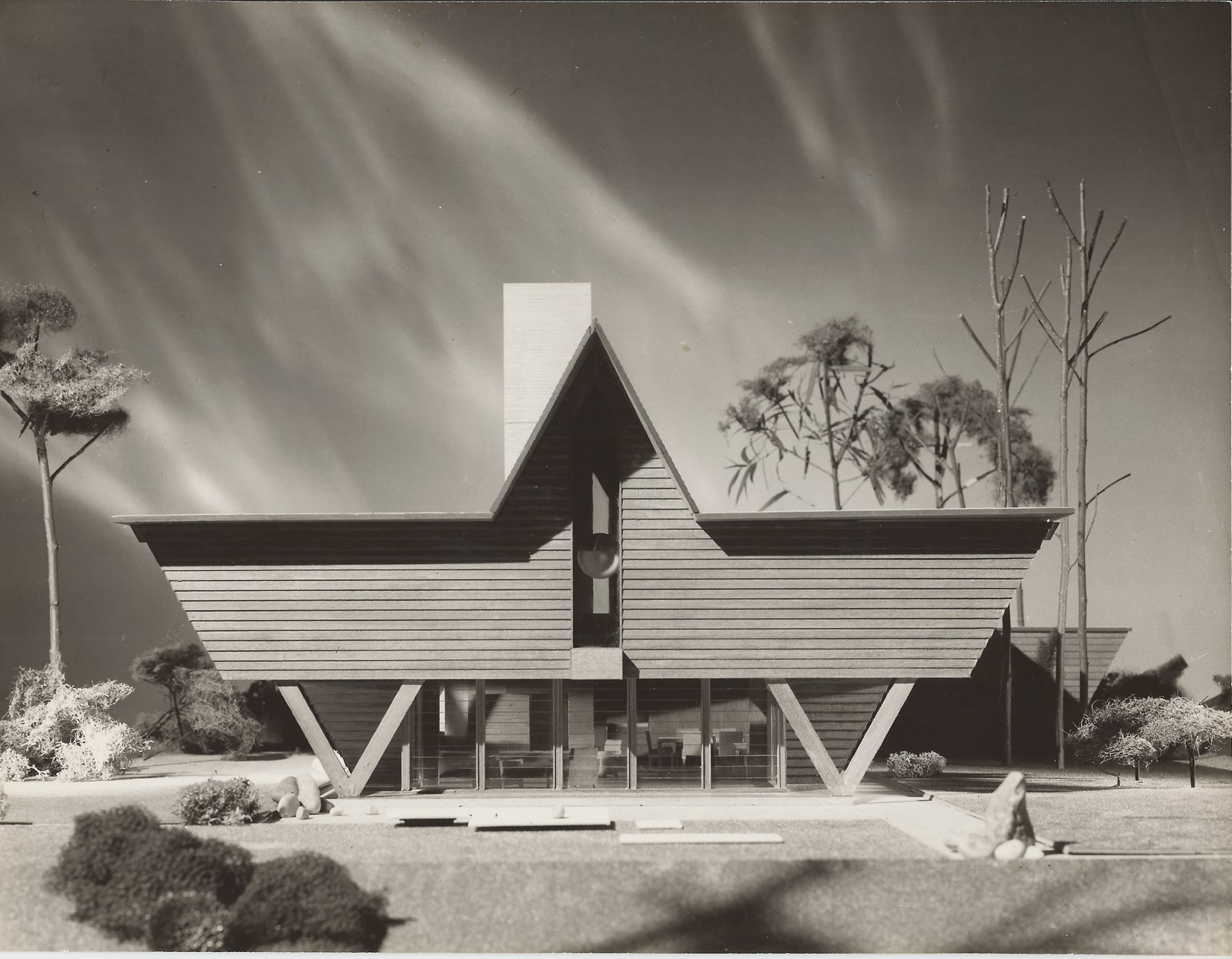 Dow's idea for his W-Frame house exists in model form (here) at the Down Home and Studio and a variant of the structure was built as the Mills Summer Home.  Photo 9 of 28 in Hometown Hero