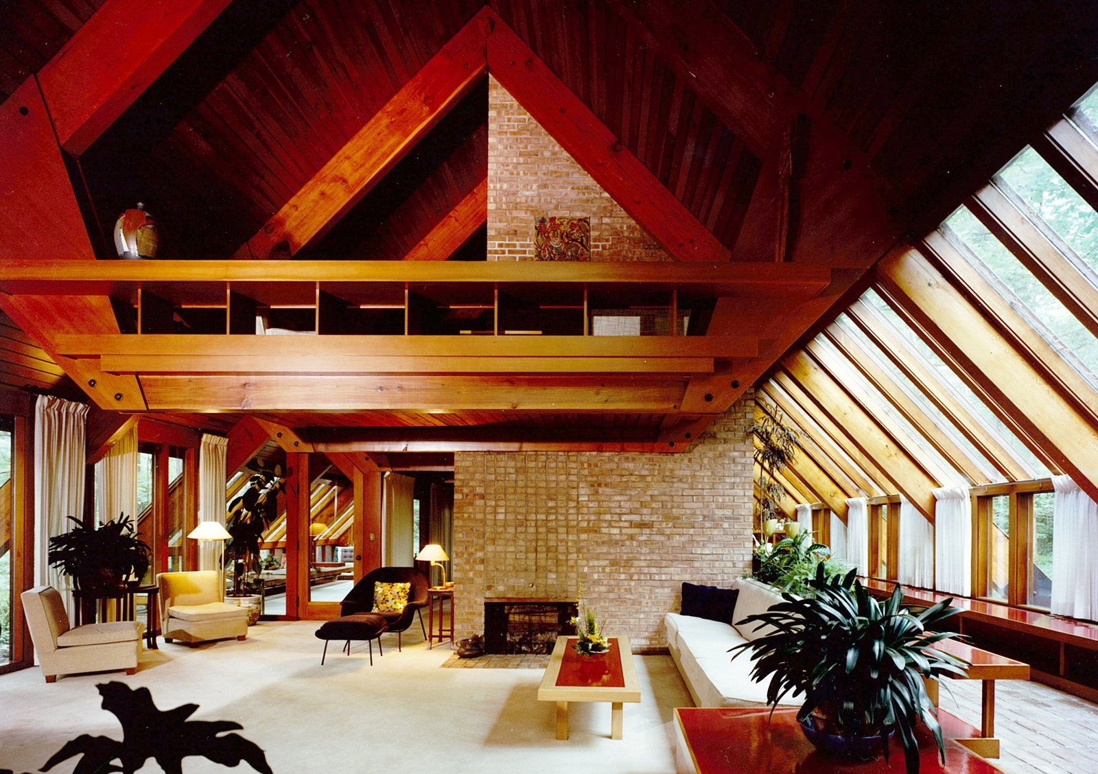 Here's an interior of the Ashmun house with its floating mezzanine and ample natural light.  Mid Modern by Jonathan Simcoe from Hometown Hero