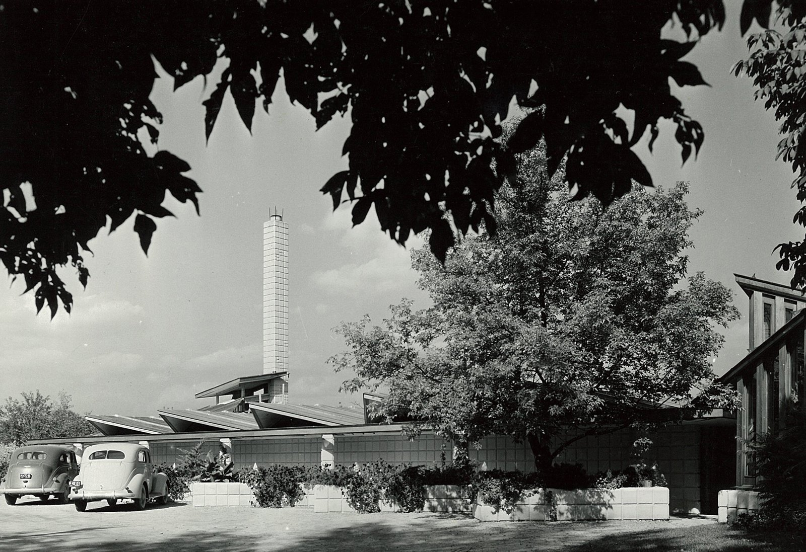 Here's a view of the entrance to the Dow Home and Studio from the 1930s. Dow loved his tall, unit-block spires, and the Dow children would climb them as they played on the home's roof.  Photo 25 of 28 in Hometown Hero