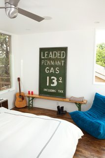 "A vintage ""Leaded Pennant Gas"" sign in the Suttles and Shah residence."