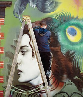 The new outdoor wall mural in progress by artist Seth Depiesse on Main Street.