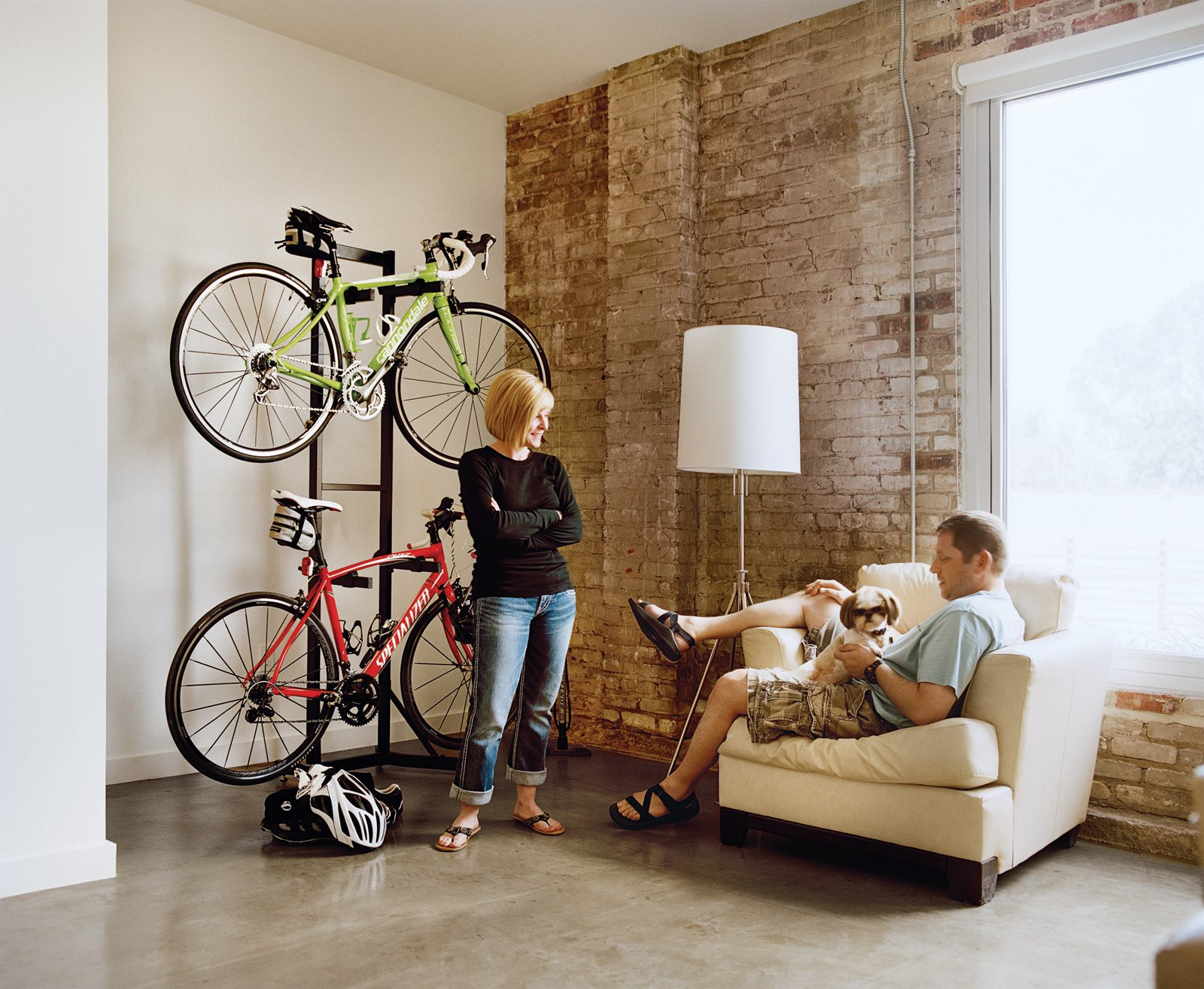 """Sofa, Storage Room, and Shelves Storage Type Loft B tenants Melissa and Keith Bishop downsized from a 3,000 square foot space to a cozy 720 square foot loft. """"We downsized our lives,"""" Melissa says. """"We streamlined.""""  Photo 1 of 1 in Melissa and Keith Bishop, Loft B"""