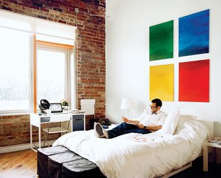 """A social creature who seems to know everyone, Loft J occupant Jamil Malone has hosted several """"alcohol-themed"""" parties and manages to wedge as many as 20 people into his studio. The gatherings are like gallery openings, with the walls of Malone's apartment displaying a roving selection of locally produced art."""