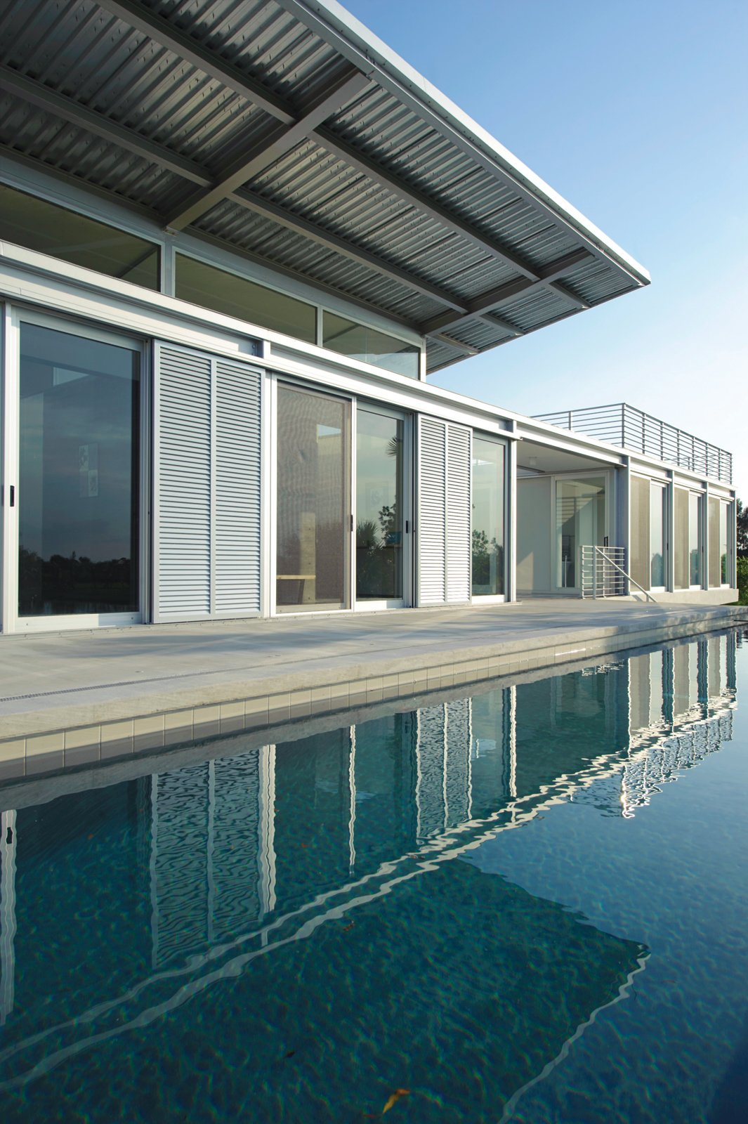 """In Hobe Sound, Florida, this passively cooled residence overlooking a custom-built water-ski circuit is hardly par for the course. """"The home is really driven by exposure to the landscape,"""" says architect Scott Hughes. Read the full story here.  Homes with a Waterfront View by Diana Budds from Ski for All"""