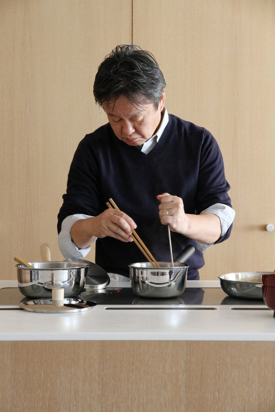 Shown here, Fukasawa busy over the cooktop.  Photo 2 of 3 in Naoto Fukasawa's Pork with Eggs