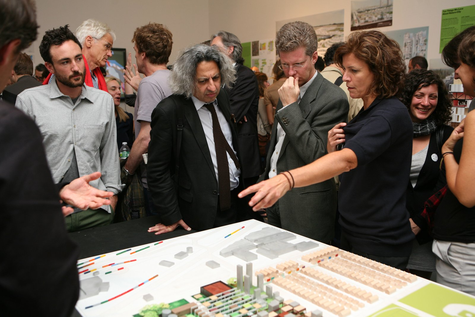 """Shaun Donovan, Jeanne Gang, and Mohsen Mostafavi, Dean of the Harvard Graduate School of Design, present Studio Gang's proposal for the exhibition.  Photo 2 of 7 in """"Foreclosed"""" Open Studio at PS1"""