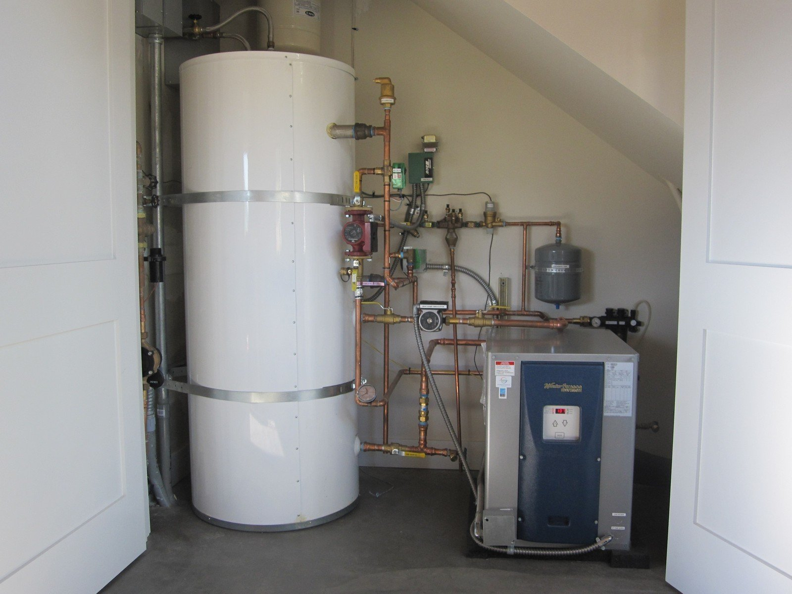 A mechanical marvel, our ground source heat pump. We'll go more granular on this in a future blog. I show it here because it's our single most important conservation item.  Photo 4 of 9 in A Zero-Energy Community: Part 2