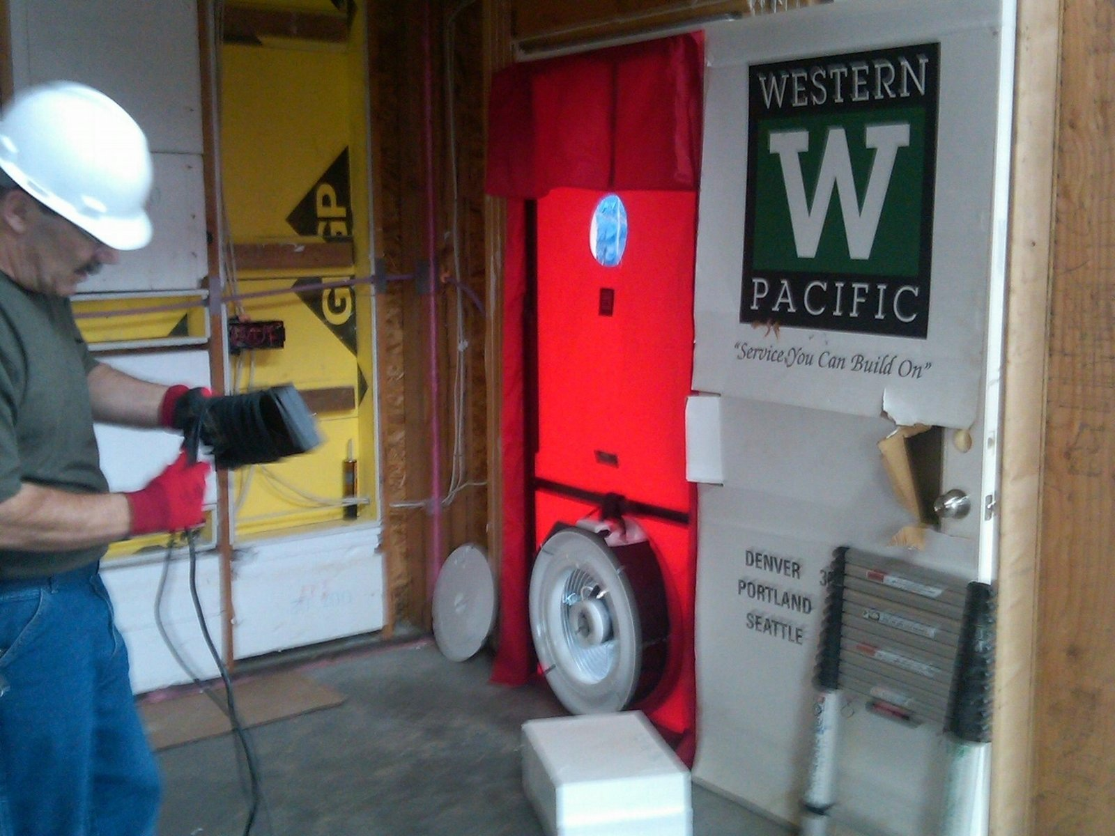 Performance-testing the home with a blower door and sealing it well is perhaps the lowest hanging fruit in the world of building energy efficiency. The blower door depressurizes the house and helps to find leak points. We sealed our homes to nearly twice what is required by code.  Photo 7 of 9 in A Zero-Energy Community: Part 2