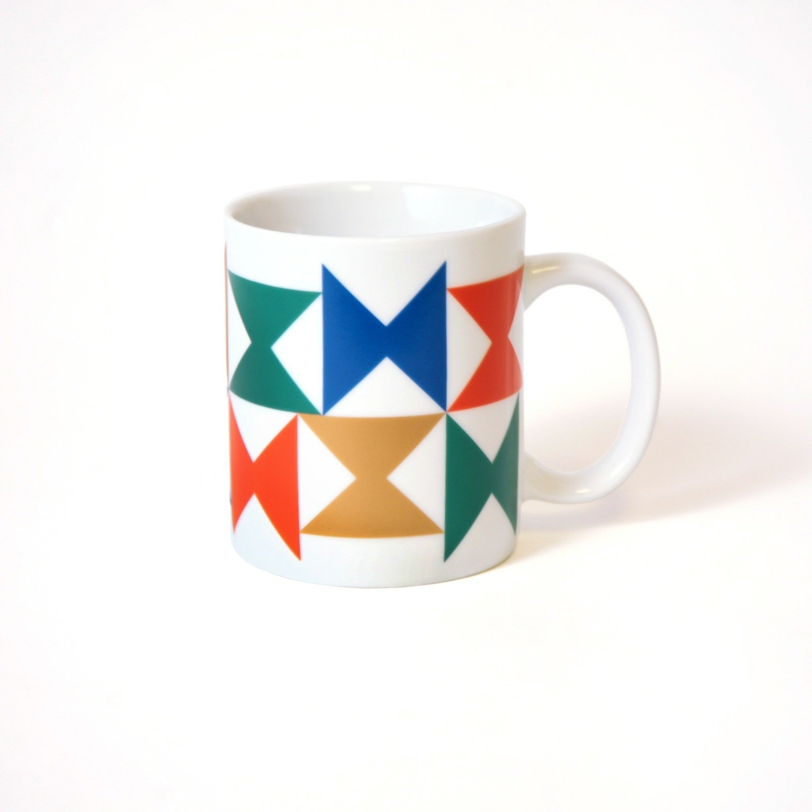 A boldly colored ceramic mug, with a pinwheel pattern for Georg Jensen tableware that was used at the Miller House.  Photo 1 of 5 in Inspired by the Miller House