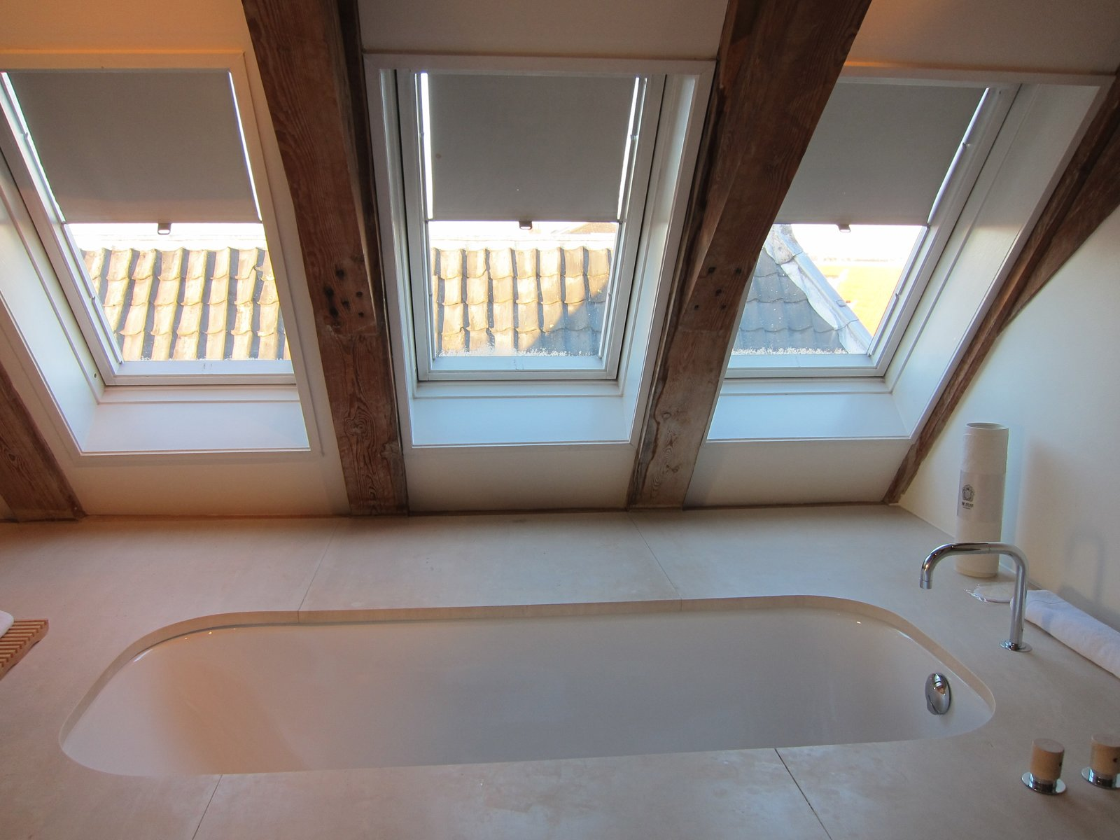 Even better—a big bathtub with views of the surrounding rooftops.  The Dylan, Amsterdam by Jaime Gillin