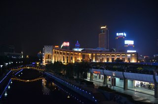"""To close out this week's report from the road, Shahid sent this image of Jinan's canal at night, which """"brought a sense of peace and quiet after a long, hard day of cycling."""" Check back soon for another slideshow from Shahid as she bikes from Beijing to Shanghai.  Click here to read part one of the series.  Don't miss a word of Dwell! Download our  FREE app from iTunes, friend us on Facebook, or follow us on Twitter!"""