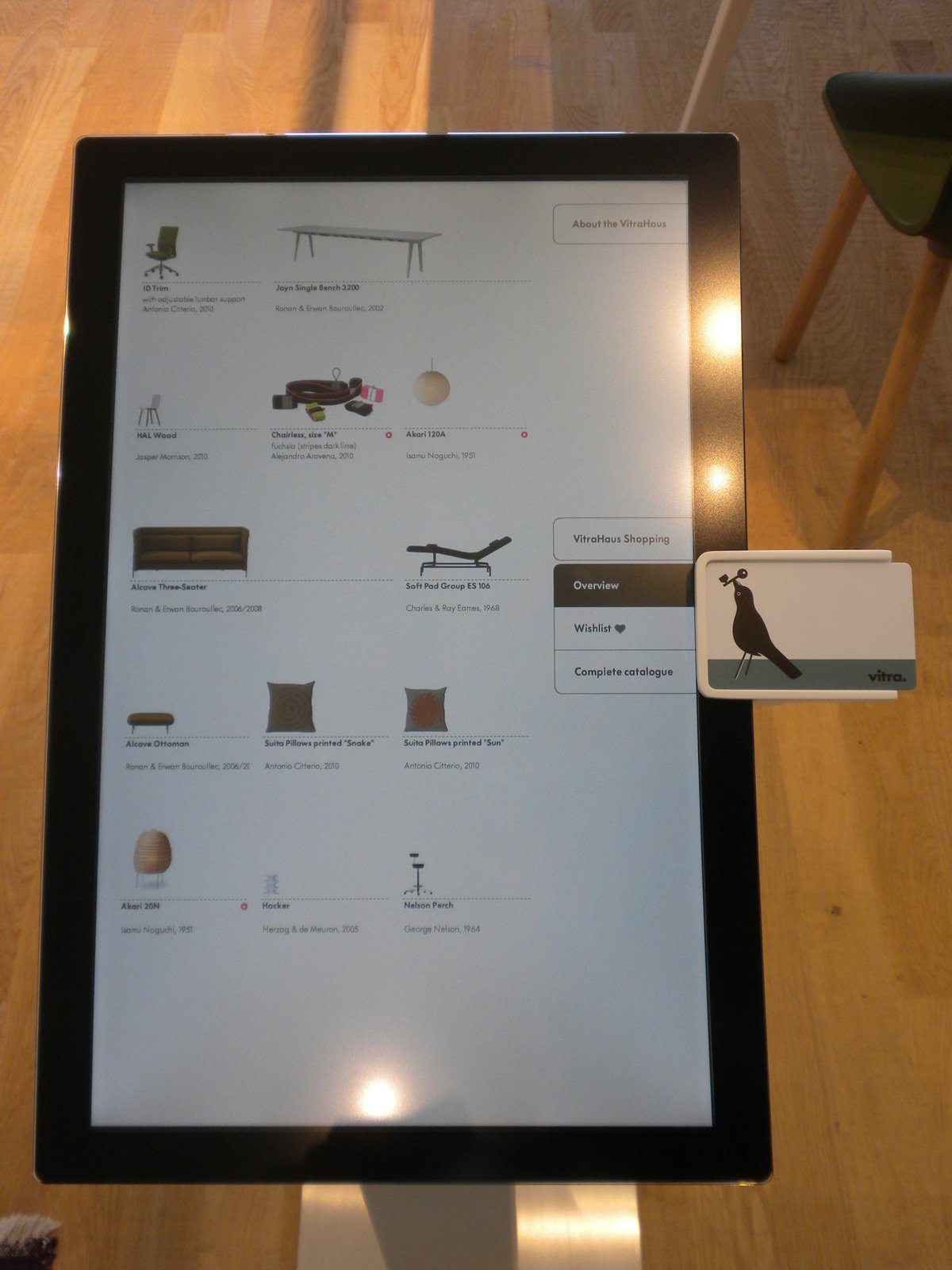"""When you enter the VitraHaus, you receive a """"Vitra Key."""" At the reception desk, you program the credit card-like key with your country of origin and your preferred language, then, as you walk around the VitraHaus, you can use it at kiosks to learn the names and designers of the pieces on display. You can even use it to wish-list products and start shopping (since every product on display is also for sale).  Inside the VitraHaus by Miyoko Ohtake"""
