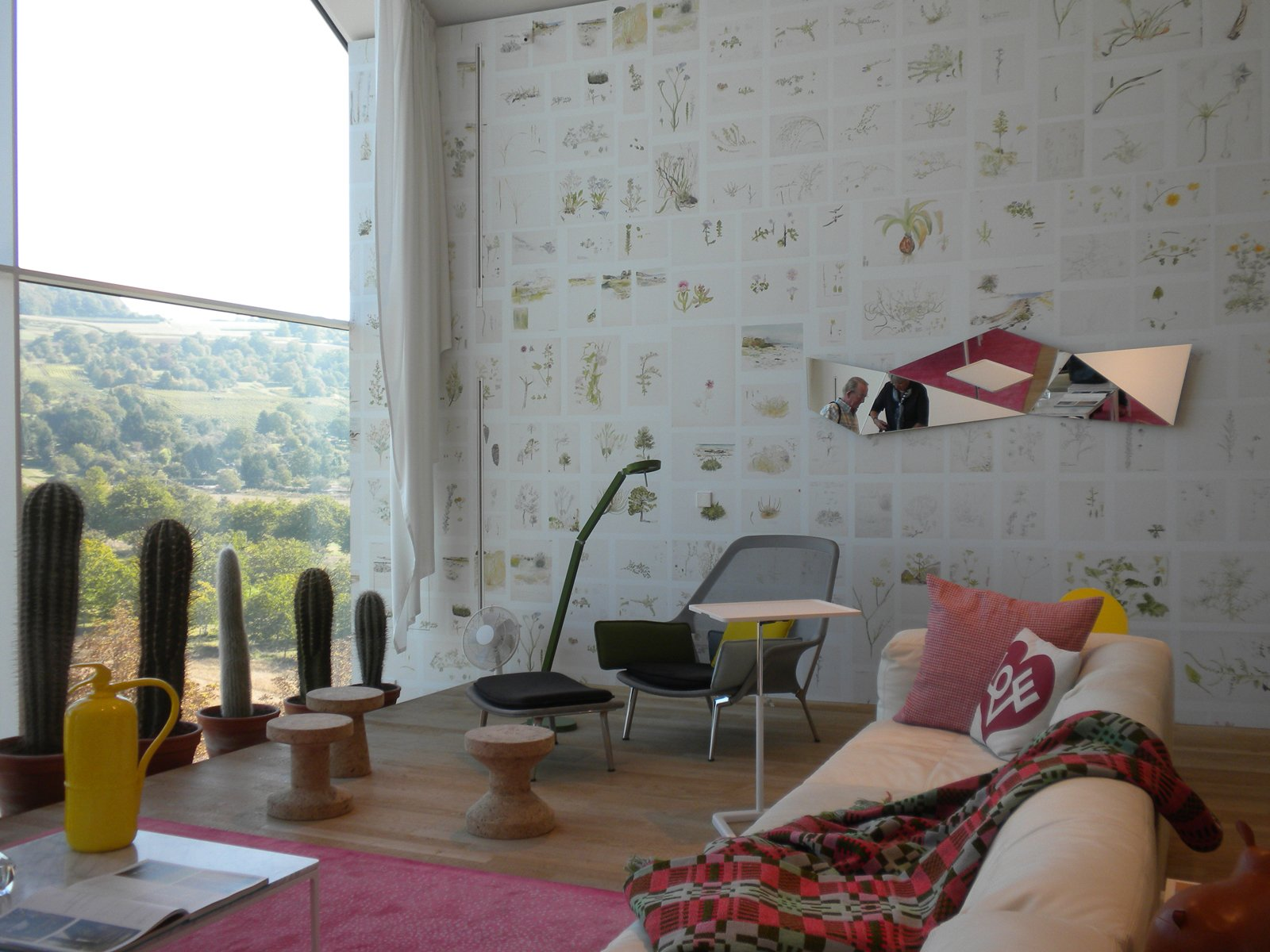 Much of the VitraHaus is set up in vignettes, like this living room scene that features the Slow Chair and Ottoman by Ronan and Erwan Bouroullec designed in 2006, the Place Sofa by Jasper Morrison designed in 2008, Morrison's Cork Family models A, B, and C designed in 2004, his Plate Table coffee tabledesigned in 2004, and the Suita Pillow by Antonio Citterio designed in 2010 using Alexander Girard's pattern Love graphic.  Inside the VitraHaus by Miyoko Ohtake