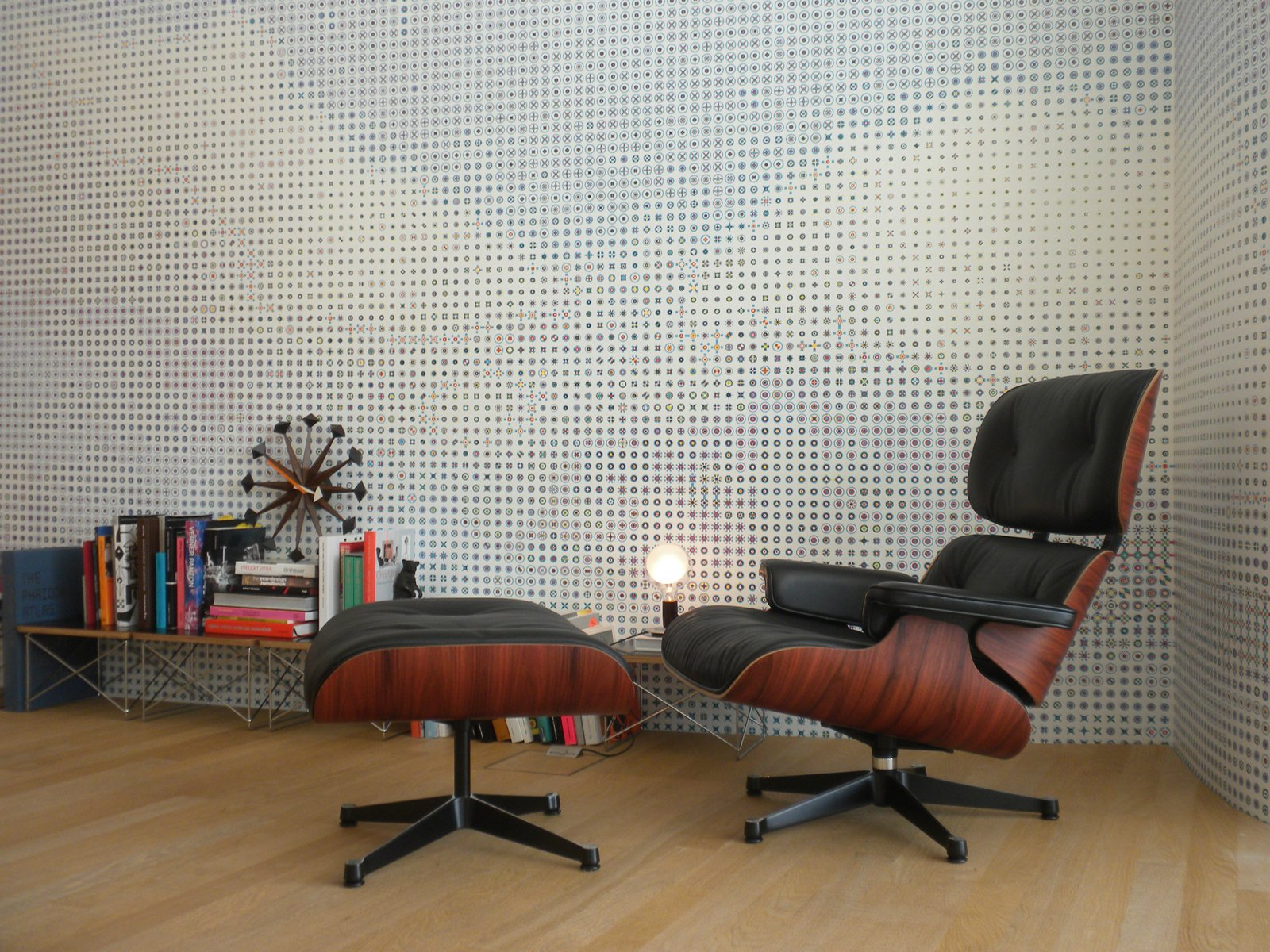 Living Room, Recliner, Ottomans, End Tables, Table Lighting, and Light Hardwood Floor On another floor, this tranquil scene features Charles and Ray's lounge chair as well as the couple's Wire Base Side Tables.  Photo 41 of 54 in Eames Lounge Chair Porn from Inside the VitraHaus