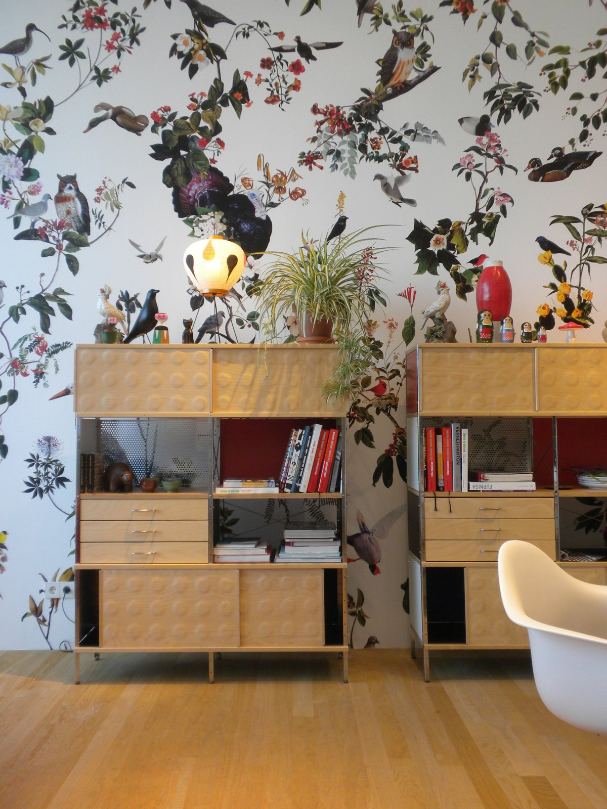 """Here, the Eames' ESU Bookcase is topped with an Eames House Bird and Akari lamp by Noguchi.  Search """"eames-house-blocks.html"""" from Inside the VitraHaus"""