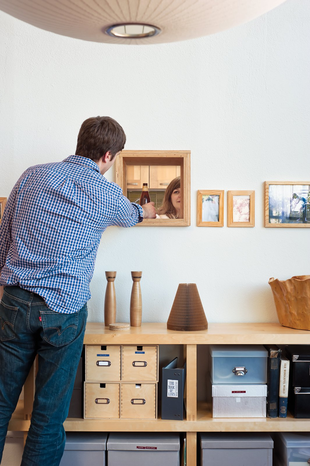 Storage Room and Shelves Storage Type Peter lined the pass-through's opening with plywood.  Photo 7 of 19 in Storage Savvy Renovation in Emeryville
