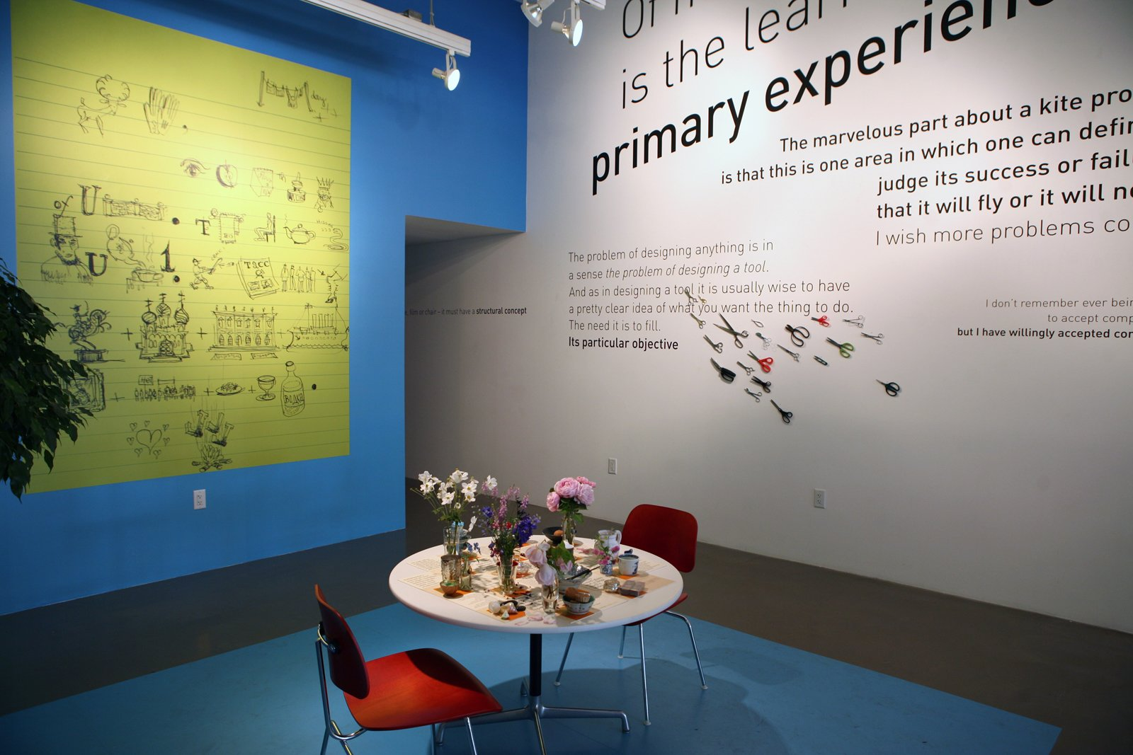 """""""This exhibition is a glimpse into Charles and Ray's daily lives,"""" says Sussman. """"They were changing the world, and the way that is expressed in this exhibit is a part of how they changed the world that is not known to everybody."""" The quotes interact with everyday objects such as scissors, a rebus drawn by Charles and a re-creation of Ray's table, flanked by new Eames LCM chairs. """"There's no vintage furniture in the exhibition,"""" notes Demetrios. """"Charles and Ray were continually designing for tomorrow.""""  Search """"game changing ideas sustainable world """" from Eames Words"""