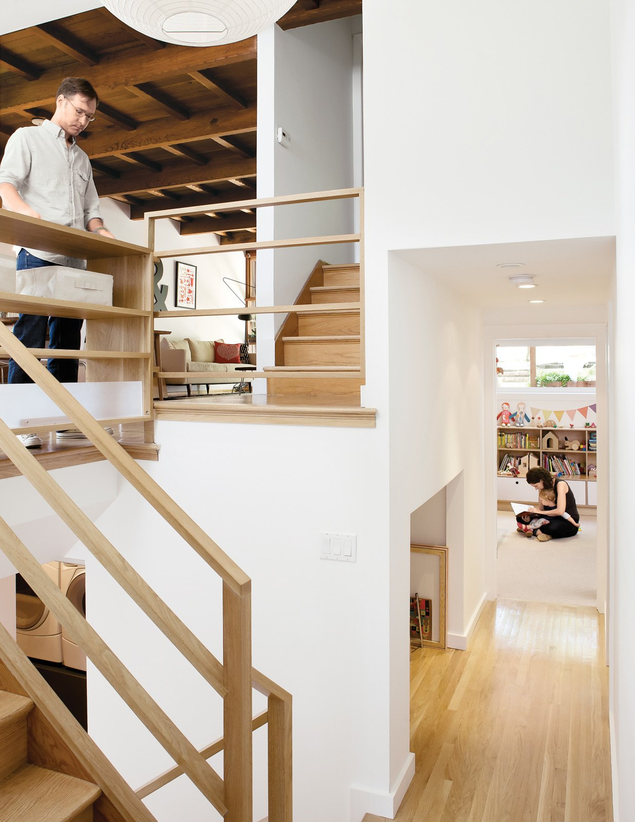 "Hallway and Light Hardwood Floor Architect Christi Azevedo, along with homeowners Lorena Siminovich and Esteban Kerner, transformed this 1,485-square-foot, multilevel, mid-century maze into a modern and efficient family home in just three months. ""It was the craziest frickin' thing,"" laughs Azevedo. ""It was like a Tetris game, putting it all together, trying to squeak out space wherever we could."" Purchased as if straight out of 1955, the home is now the ideal small space for Siminovich and Kerner to raise their young daughter, Matilda.  Best Photos from A Couple Tackles Conversion Challenges and Builds a Modern Renovation"