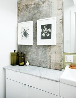 """Though only two feet deep, the Ikea cabinet Azevedo bought for the guest bath didn't quite fit, so she sliced off eight inches with a table saw. """"It might be unorthodox, but it was just easier, faster, and cheaper to do it myself,"""" says the former furniture designer."""
