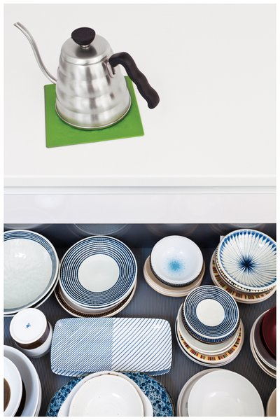 Organization is critical in keeping the Tatami House's minimalist vibe intact. Shoko keeps the kitchen drawers tidy.