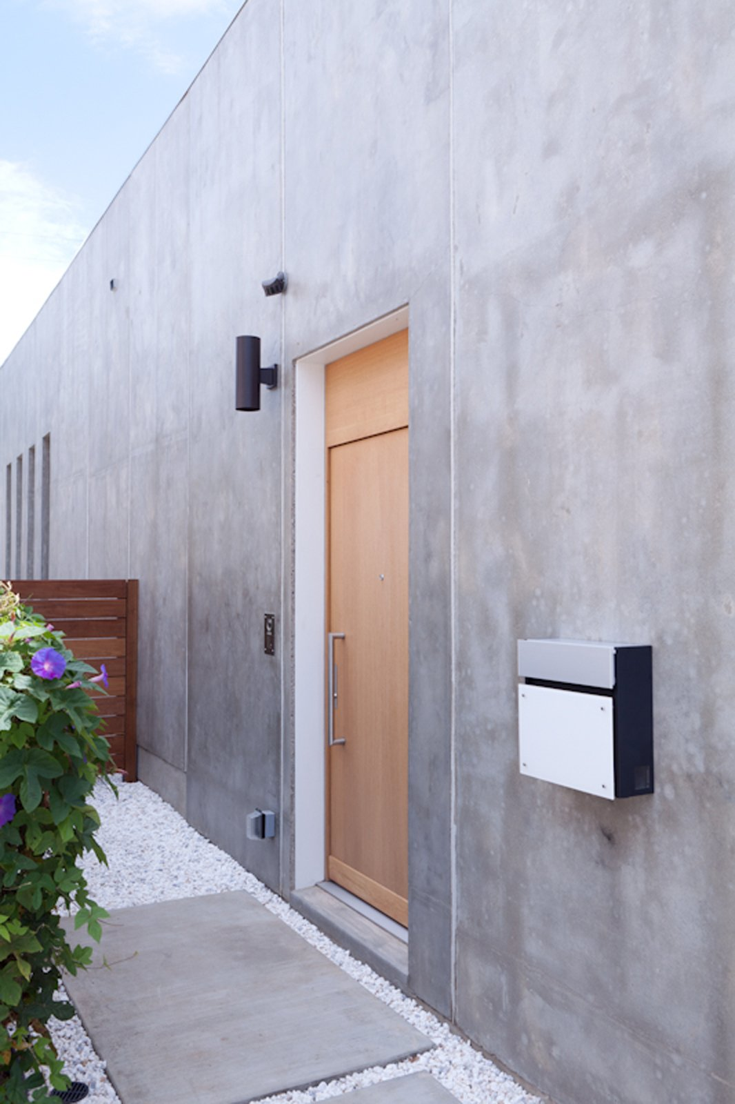 The door to the house is actually on the side of the house, further adding to the sense of privacy the Shozis sought.  Photo 14 of 19 in Looking Inward
