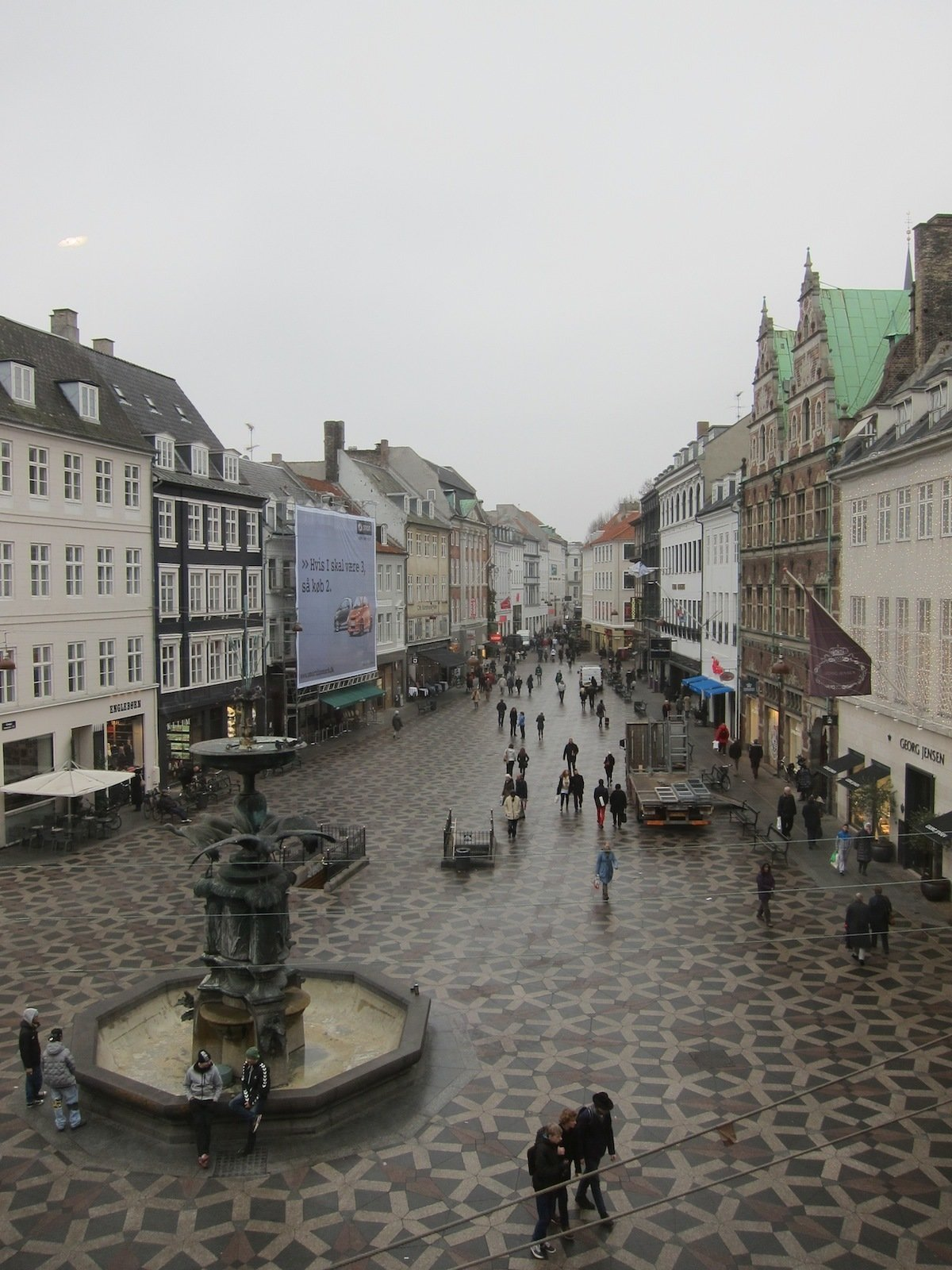 The shop overlooks the city's main shopping street, with pretty paving and high-end shops tucked into grand historic buildings. This is the view from one of Hay's windows. It's a strenuously charming city even on the grayest day.  A Visit to HAY Copenhagen by Jaime Gillin