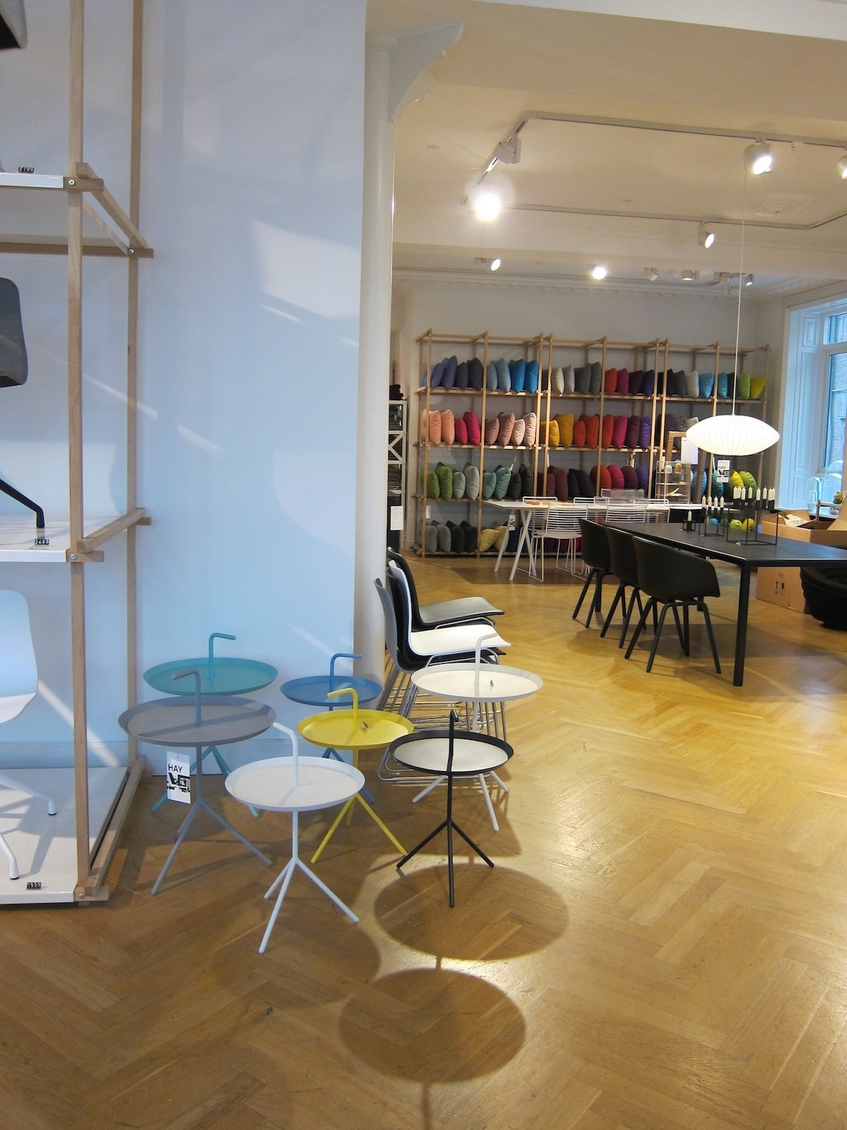 A cluster of powder-coated steel DLM tables, by local designer Thomas Bentzen. Check out the handy handle for toting it around.  A Visit to HAY Copenhagen by Jaime Gillin