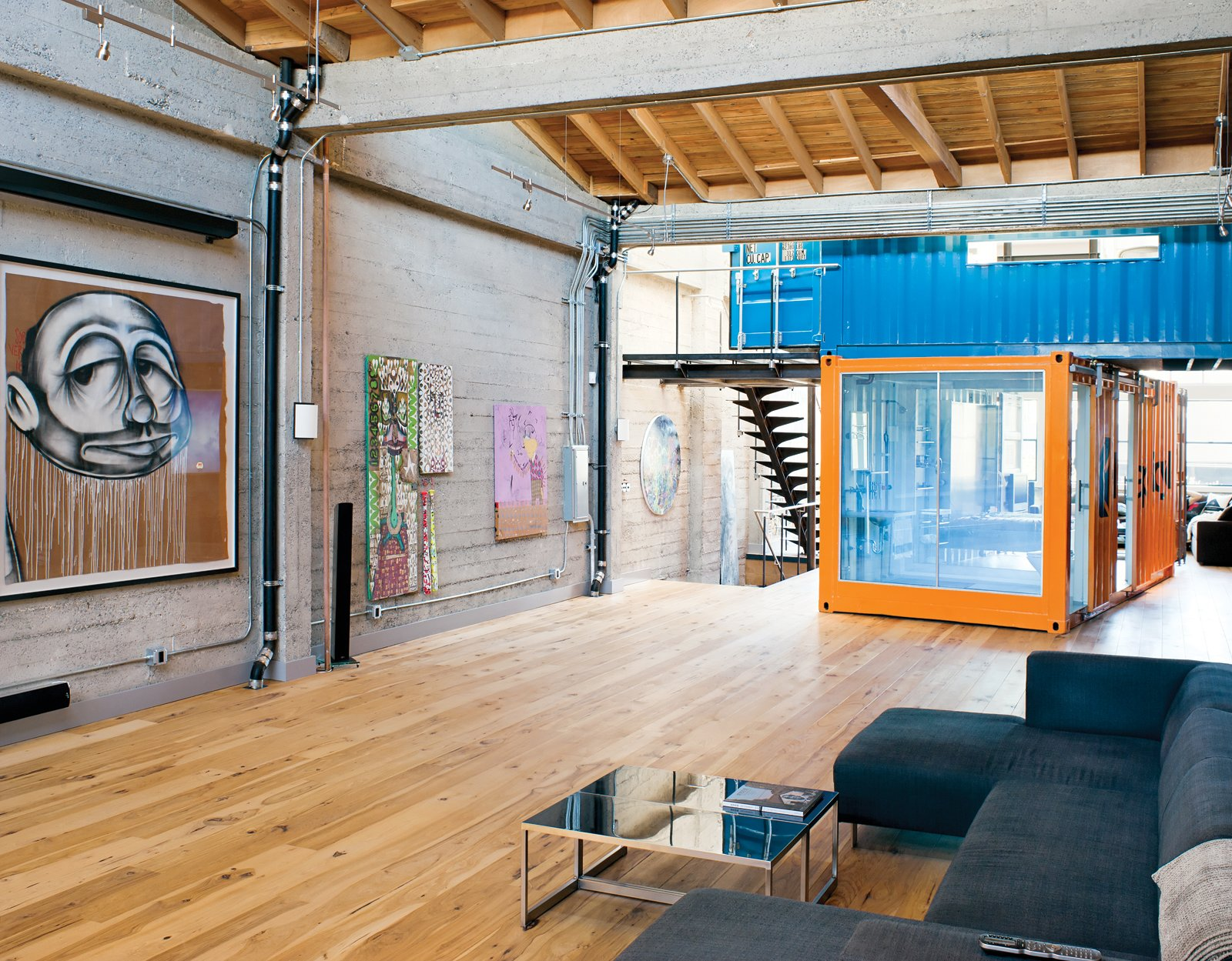 The shipping containers were stacked, joined with steel tubes, and lashed to reinforced floor joints to make them earthquake-safe. Tagged: Living Room, Sofa, Light Hardwood Floor, and Coffee Tables.  Shipping Container from Modern Shipping Container Home in San Francisco