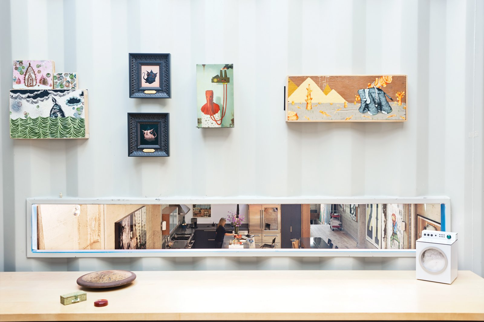 """Wardell's office boasts a rectangular cutout the couple calls the """"dinner's ready slot"""" for its bird's-eye perspective on the kitchen.  Photo 1 of 10 in Modern Shipping Container Home in San Francisco"""