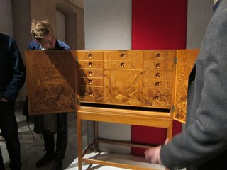 """One of the biggest delights of the exhibition was this exquisite, subtly ornate cabinet by Hans J. Wegner. """"Wegner thought everything should be square and the form should be very rational,"""" said Olesen. """"But there's a party inside!"""" The """"party""""—consisting of 3000 pieces of inlaid wood on the interior—was created by hand by Wegner, a trained cabinetmaker, who did all the work himself in his apartment over 14 days."""