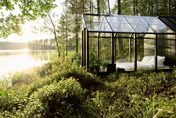 This dreamy, glass bedroom by the lake was created as an early prototype for the prefabricated greenhouse/she kits known as the Kekkilä Green Sheds.
