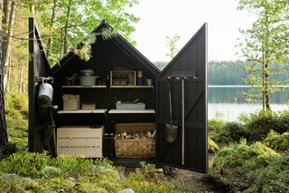 The wood shed portion artfully encapsulates all the domestic detritus that would be anathema within the all-glass sleeping portion.