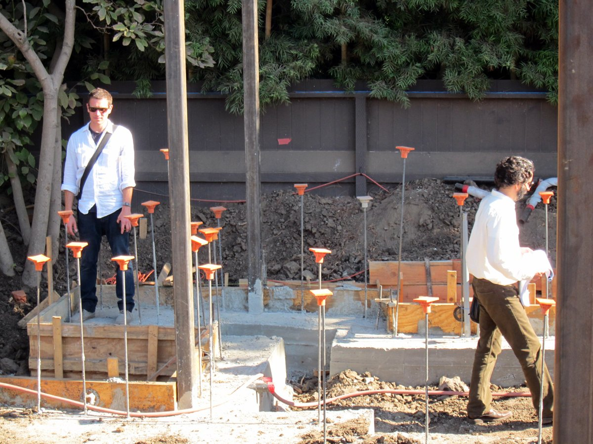 Project Manager Jeff Svitak and Designer Sebastian Mariscal inspect the poured footings, steel posts and plumbing.  Photo 2 of 4 in Dwell Home Venice: Part 8