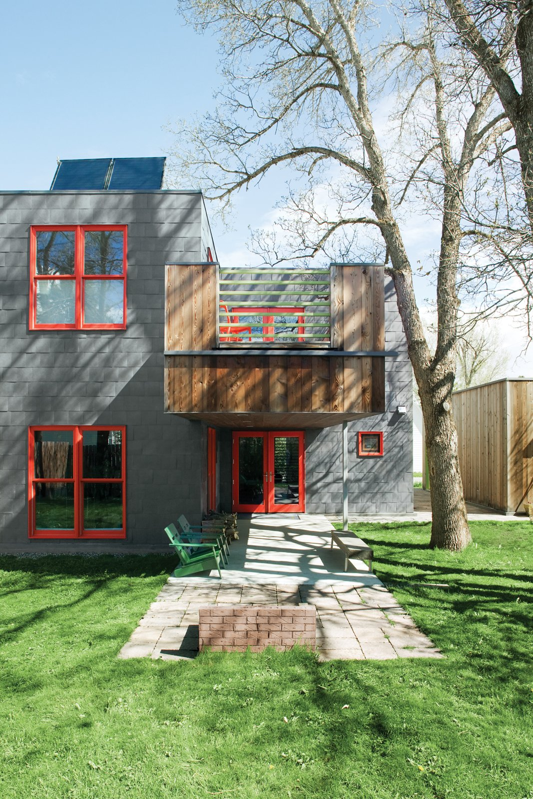 "Outdoor, Small Patio, Porch, Deck, Concrete Patio, Porch, Deck, and Grass Just Glaze  Double-glazed windows are typically composed of two layers of glass with a layer of air in between. You might spend more on them upfront ($200–$1,500 each), but the extra insulation can save loads on your heating bill and more than recoup your investment over time. weathershield.com  Search ""color story green"" from A Sound Professional Goes DIY While Building an Affordable Montana Home"