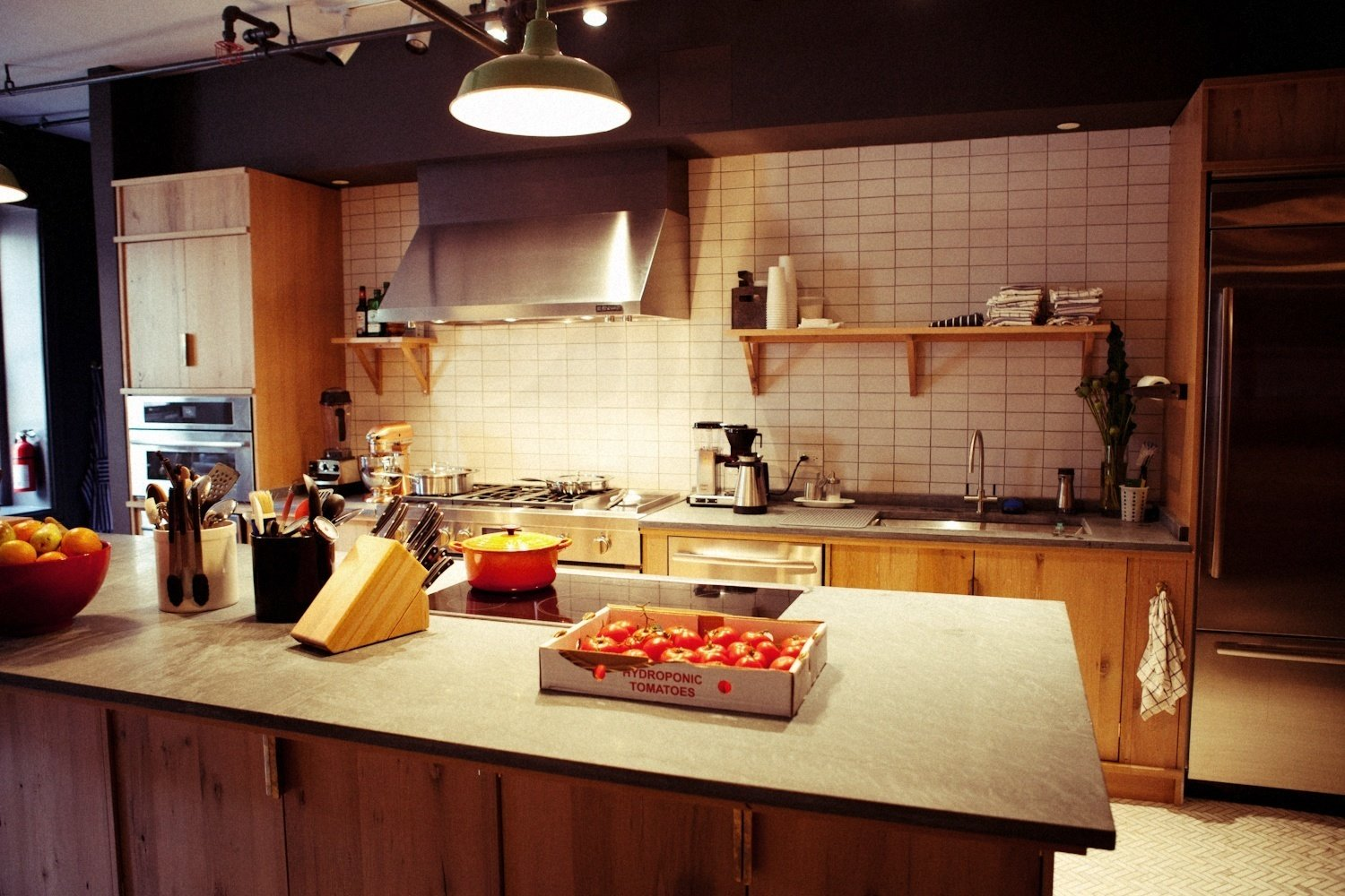 The builders value-engineered the project to maximize the limited budget. They usually have very high-end clients but they embraced this project because they were excited to help build a space for the next generation of chefs, mixologists, and sommeliers.  Test Kitchen Before-and-After by Jaime Gillin