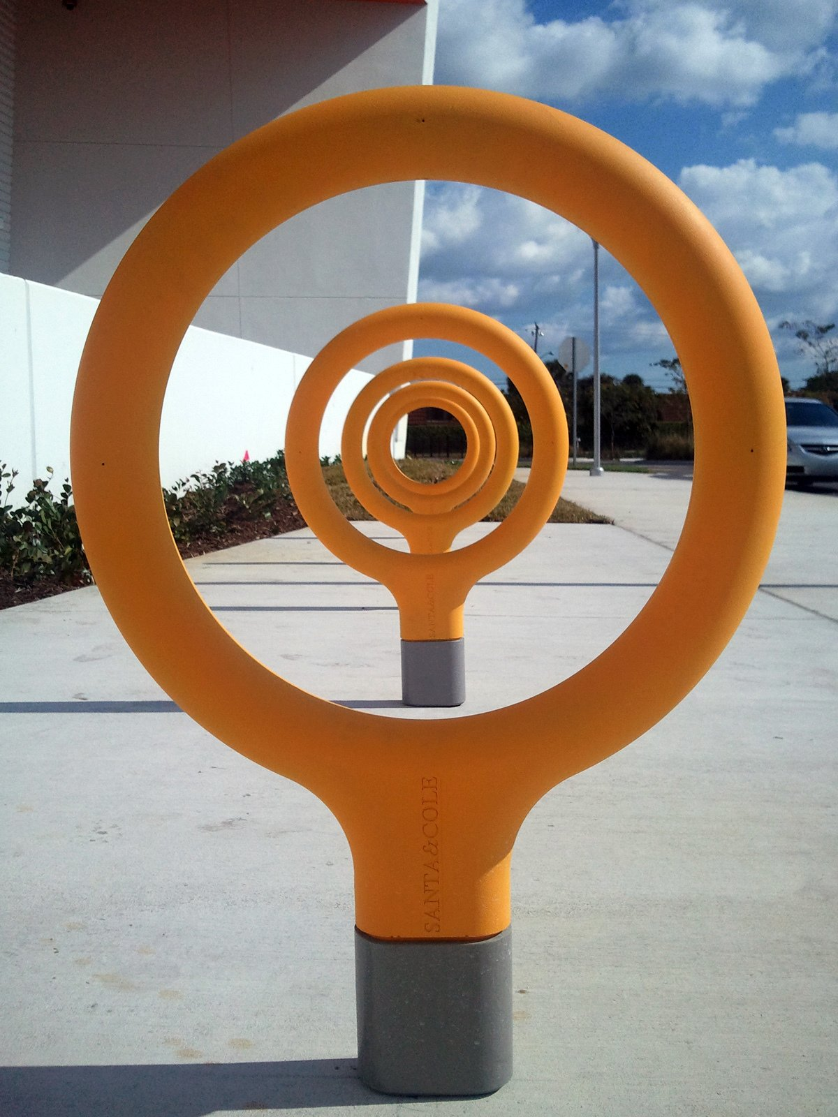 """Key Bike Rack by Santa & Cole  Nothing says locking up your bike like a """"key"""" rack, created by Spanish designers Santa & Cole. This brightly colored design—yellow and red are just a couple of the options—provides some flair to any sidewalk, offering a powerful security tool and admirable aesthetics at the same time (as seen in this photo from Fort Lauderdale, Florida).  Street Furniture Your City Wishes it Had by Tim Newcomb"""