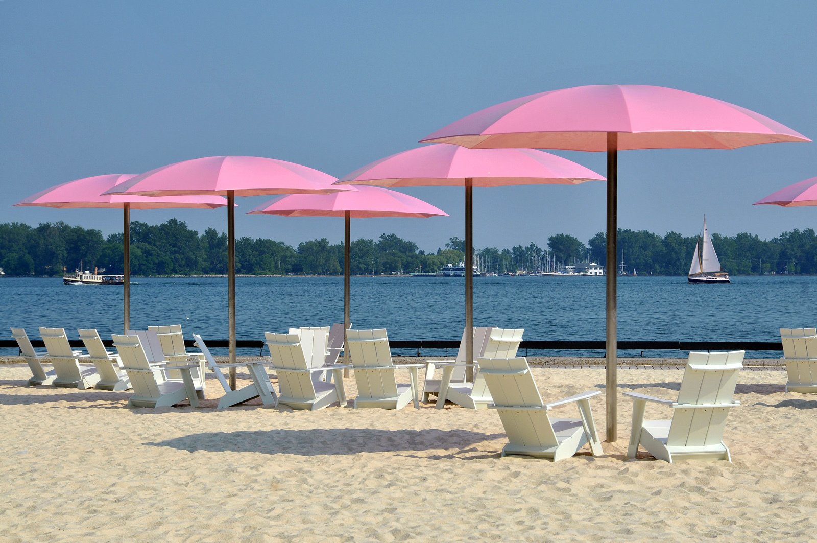 Pink Umbrellas by Claude Cormier  Canada's Sugar Beach, located in downtown Toronto, offers a whimsical way to experience sand and water in an urban environment. To ratchet up the fun, Montreal designer Claude Cormier dreamed up these pink umbrellas to shade visitors in an area also featuring a colorful fountain display. The hues at Sugar Beach fit the name and contrasts the downtown core.  Photos from Street Furniture Your City Wishes it Had