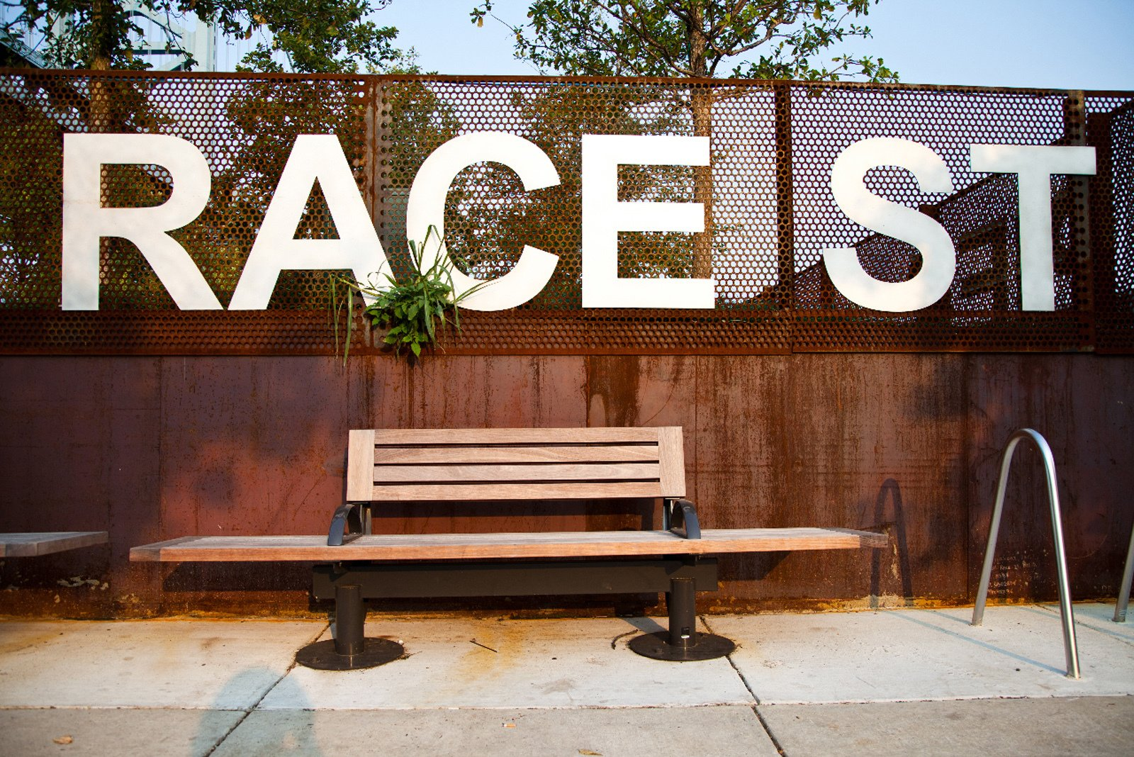 Nu Line Bench by Landscape Forms  Race Street Pier in Philadelphia utilizes off-the-shelf benches and furnishings from Landscape Forms' Nu Line to give visitors a way to experience the views on the newly created waterfront park. The wide benches encourage lounging and the wooden viewing stands nearby offer the chance to lean back and relax while looking out towards the water. There's a little something for everyone, it seems.  Street Furniture Your City Wishes it Had by Tim Newcomb