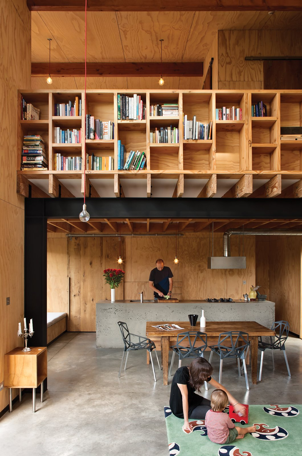 Concrete Floor, Wood Backsplashe, Pendant Lighting, Concrete Counter, Shelves Storage Type, Shed & Studio, and Storage Space Room Type Davor (with his wife, Abbe, and son, August) designed the main living and dining pavilion as a double-height space to increase its perceived volume, and added high cubbies for extra storage.  Small Spaces from Rock the Boat