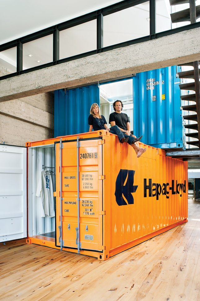 Their solution was to stack two shipping containers on top of each other, to create private space within the open-plan living area.  20 Ideas On What You Can Do With Old Shipping Containers from Coolest Homes for Artists & Art Collectors