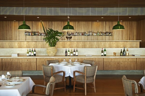 The restaurant bar provides a casual hangout for guests. The central credenza, usually occupied by the daily breakfast buffet, was designed by architect Isay Weinfeld.